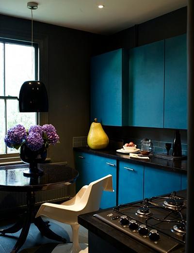 kitchen with dark blue cabinets