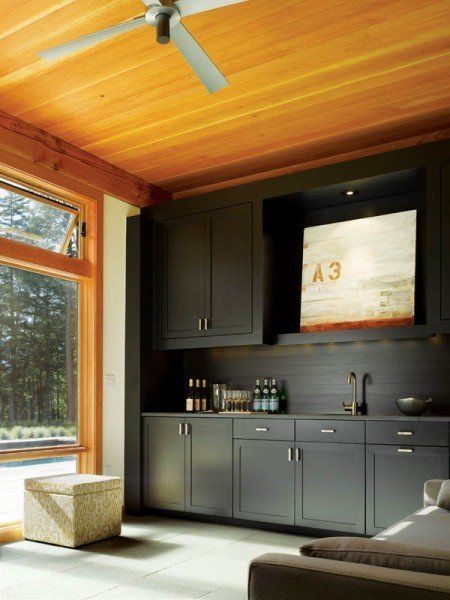 honey tone wood and black cabinets