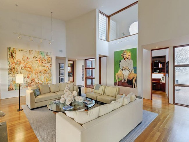 living room with a high ceiling