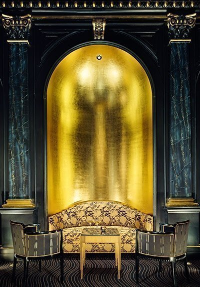 dramatic black and gold sitting room